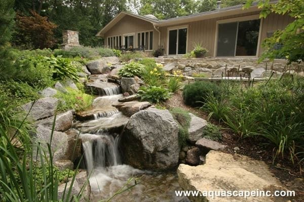 landscape ideas for a sloped yard how to build it. Black Bedroom Furniture Sets. Home Design Ideas