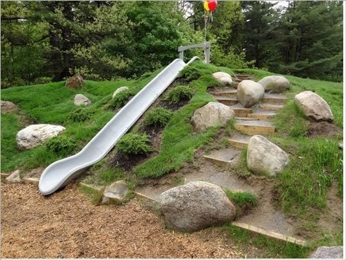A slide is a great slope yard landscaping idea