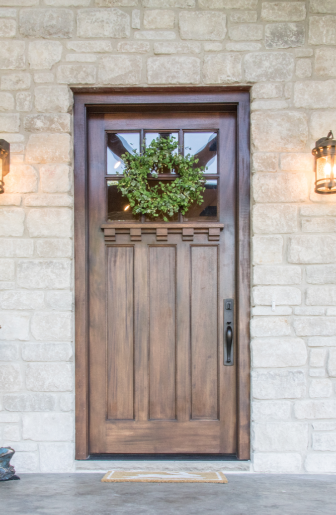 Adding a wreath makes your front door look so much more welcoming! If your front door needs a little love, here 's how to renovate a front door.