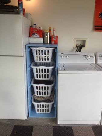 Great way to add storage for laundry baskets- DIY laundry room project