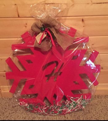 red DIY snowflake with monogram wrapped up as a gift