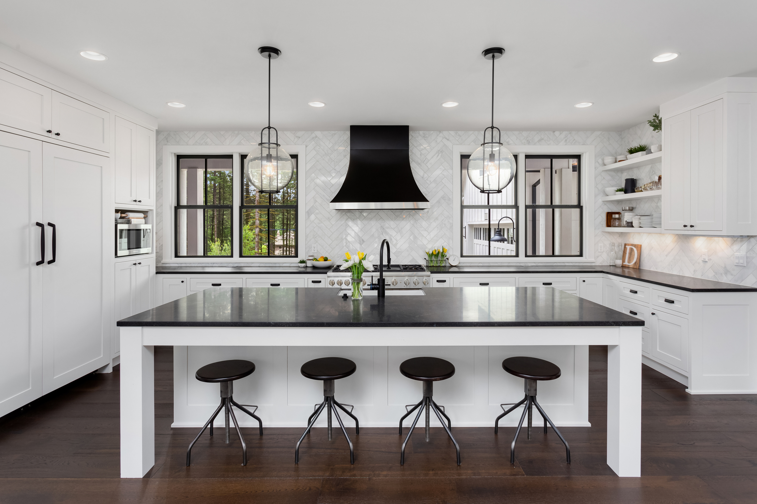One of the biggest trends in kitchen designs right now is black and white. I personally love white cabinets black granite. Look here for more black and white kitchen designs.