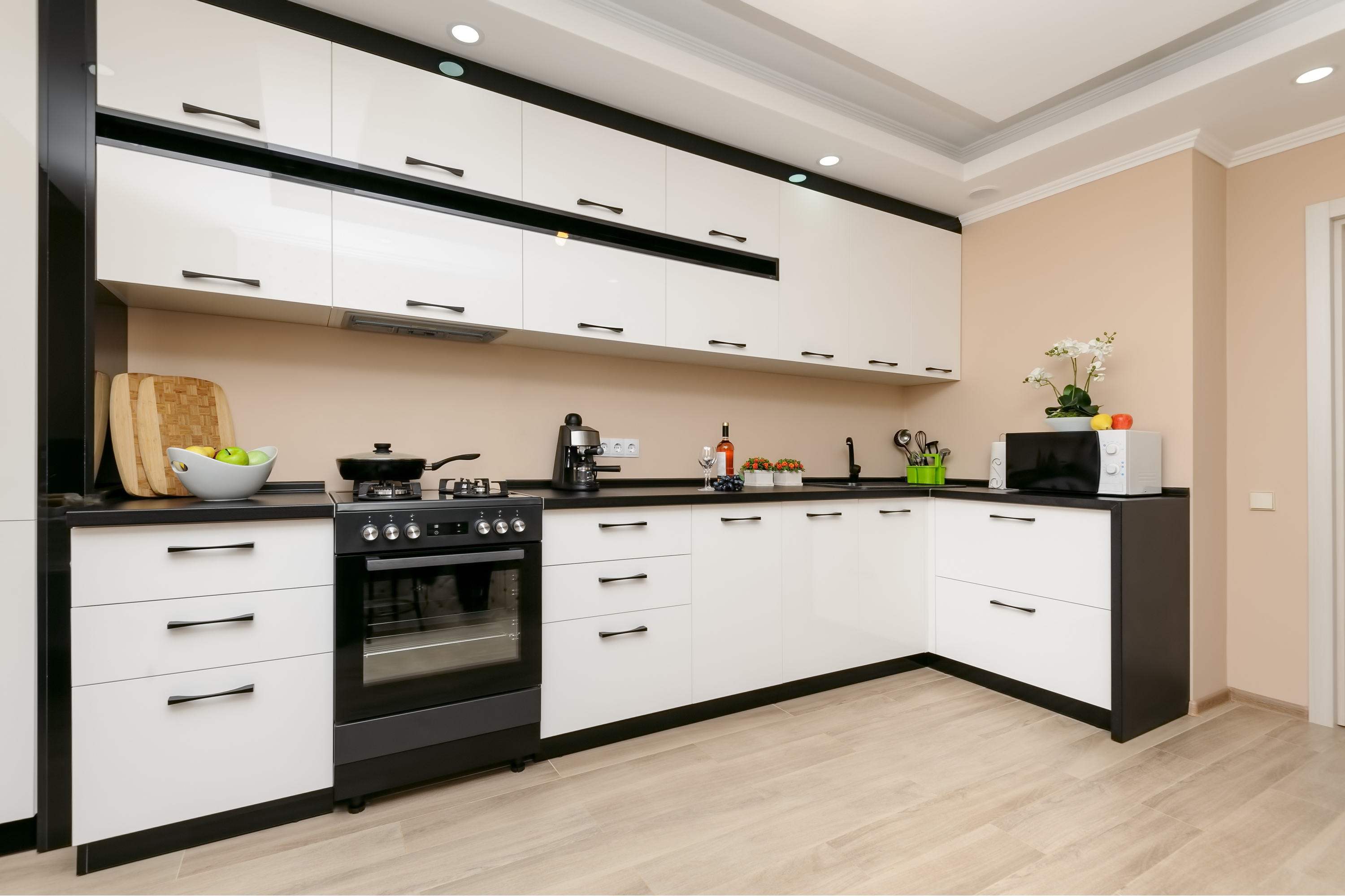 """The saying """"opposites attract"""" is definitely true when it comes to kitchen design. I love the look of white cabinets black granite. It looks amazing!"""