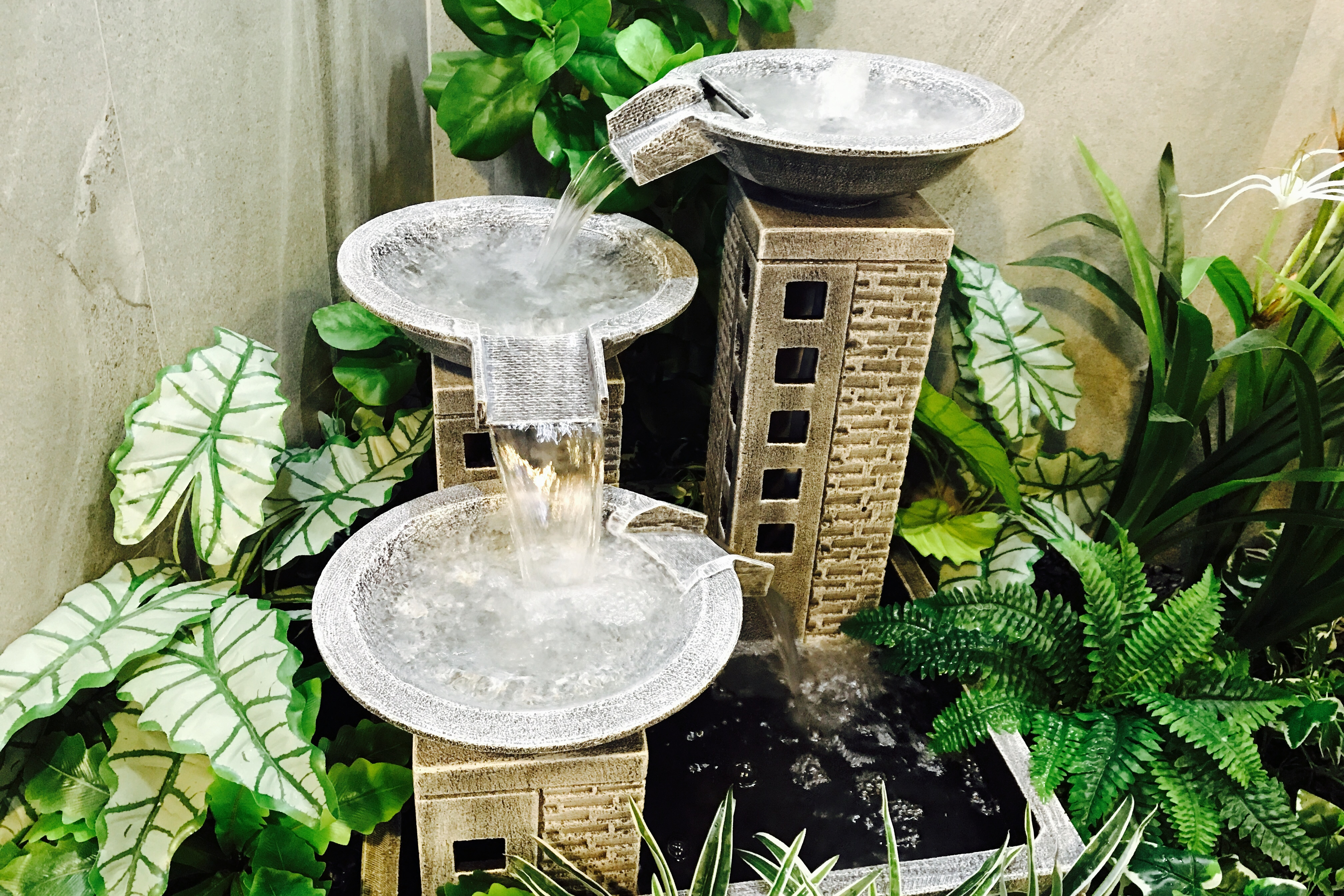 If you're looking for a little peace and quiet, or a way to be more mindful, you need to add one of these indoor water fountains to your home. This indoor water fountain with plants will be the most relaxing place in your home.