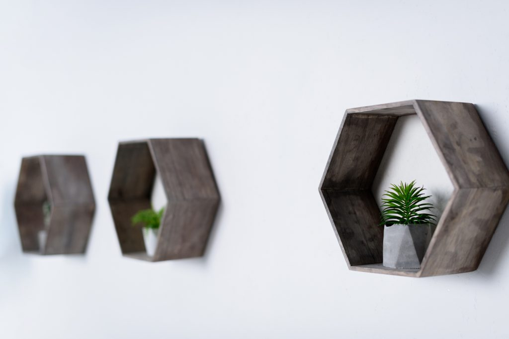 A few days ago, I was checking in on some of my favorite home decor bloggers when one of them posted a set of STUNNING honeycomb hexagon shelves on her wall. I immediately knew that I wanted some in my own home. If you want some too, use this tutorial to make it happen.
